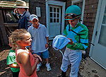 Jockey Ramon Dominguez signs autographs for fans on Delaware Handicap Day at Delaware Park in Stanton, Delware on July 16, 2011.