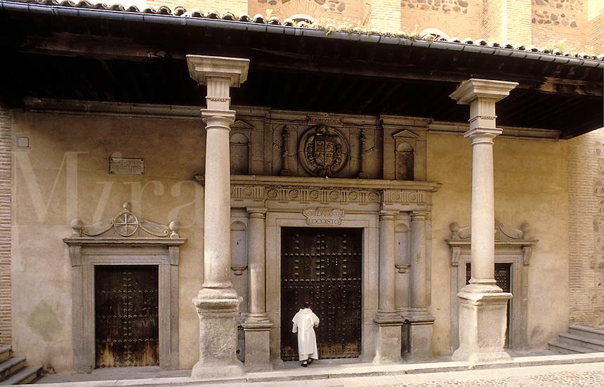 Spain. Toledo. Castile La Mancha.  Monk entering ancient monastic building.