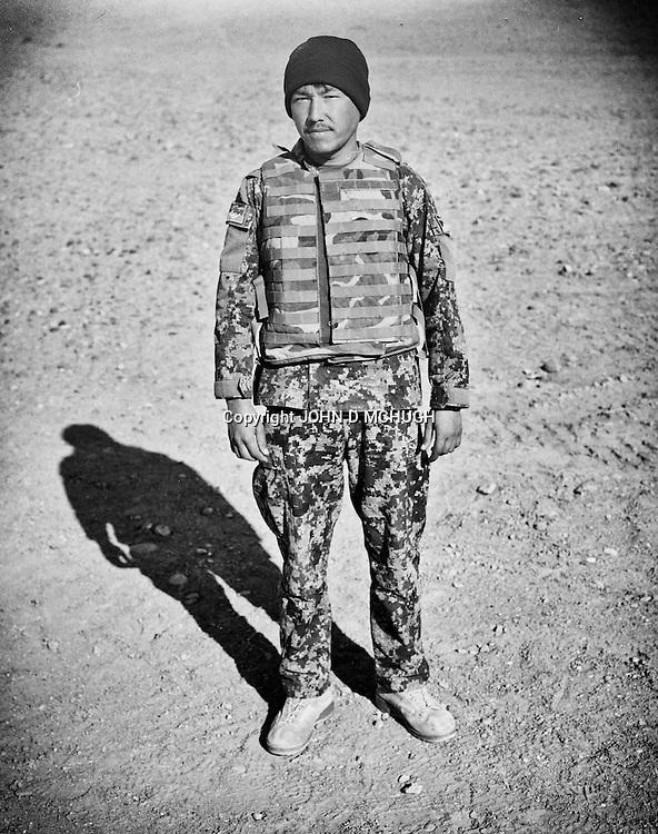 Sergeant Zabi Ullah, of the Afghan National Army, is seen at the Regional Military Training Centre in helmand, 12 November 2012. This portrait was shot on a 5x4 Linhof Technika IV, circa 1959, and a Voigtlander Braunschweig Heliar 15cm lens, circa 1922. (John D McHugh)