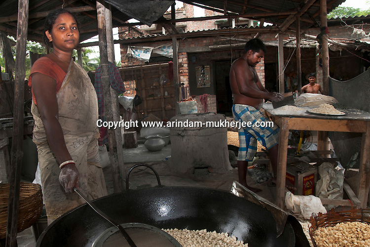 Aloka Sardar (28) working in her food factory where she produces different kinds of Snacks. She earns about 600 usd/month. She is a benificiary of Bandhan - one of the biggest micro credit company in India. Nikarighata village, Canning, West Bengal, India. Arindam Mukherjee