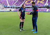ORLANDO, FL - FEBRUARY 21: Rose Lavelle #16 talks to Milan Ivanovic of the USWNT before a game between Brazil and USWNT at Exploria Stadium on February 21, 2021 in Orlando, Florida.