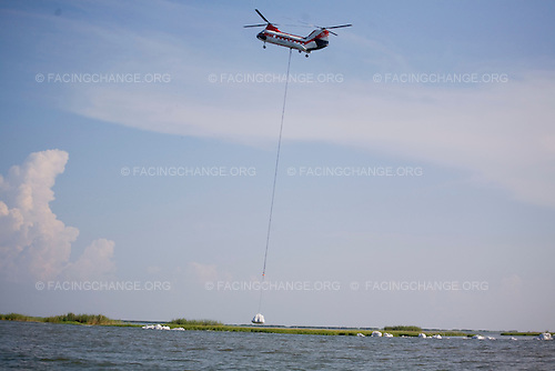 Barrier Islands off Venice, Louisiana.June 15, 2010..Helicopters dropping 3000-lb. sandbags to build up an artificial breakwater or berm against BP Deepwater Horizon oil spill..