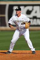 UCF Knights first baseman D.J. Hicks #42 in the field during a game against the Siena Saints at the UCF Baseball Complex on March 3, 2012 in Orlando, Florida.  UCF defeated Siena 6-4.  (Mike Janes/Four Seam Images)