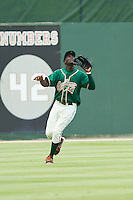Greensboro Grasshoppers center fielder Juancito Martinez (44) tracks a fly ball during the South Atlantic League game against the Kannapolis Intimidators at CMC-Northeast Stadium on July 13, 2013 in Kannapolis, North Carolina.  The Intimidators defeated the Grasshoppers 7-5.   (Brian Westerholt/Four Seam Images)