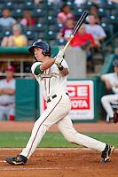 Chase Austin #8 of the Greensboro Grasshoppers watches the flight of the first of his two home runs on the day against the Lakewood BlueClaws at NewBridge Bank Park July 6, 2010, in Greensboro, North Carolina.  Photo by Brian Westerholt / Four Seam Images