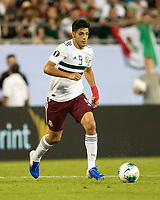 CHARLOTTE, NC - JUNE 23: Raul Jimenez #9 dribbles the ball during a game between Mexico and Martinique at Bank of America Stadium on June 23, 2019 in Charlotte, North Carolina.