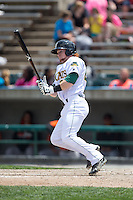 Clint Frazier (20) of the Lynchburg Hillcats follows through on his swing against the Frederick Keys at Calvin Falwell Field at Lynchburg City Stadium on May 14, 2015 in Lynchburg, Virginia.  The Hillcats defeated the Keys 6-3.  (Brian Westerholt/Four Seam Images)
