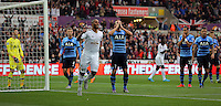 Harry Kane of Tottenham Hotspur (C) holds his head in his hands after scoring an own goal, Ashley Williams of Swansea celebratesnext to him  during the Barclays Premier League match between Swansea City and Tottenham Hotspur played at The Liberty Stadium, Swansea on October 4th 2015