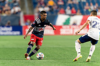FOXBOROUGH, MA - AUGUST 18: A.J. DeLaGarza #28 of New England Revolution dribbles during a game between D.C. United and New England Revolution at Gillette Stadium on August 18, 2021 in Foxborough, Massachusetts.