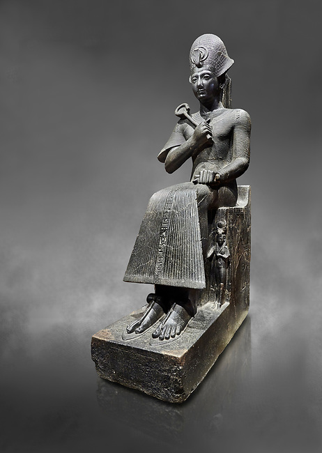 Ancient Egyptian statue of Ramesses II. granodiorite, New Kingdom, 19th Dynasty, (1279-1213 BC), Karnak, Temple of Amon. Egyptian Museum, Turin. Grey background.<br /> <br /> Ramesses II is depicted in all his majesty in this ststue. He wears a Khepresh crown and holds the heqa sceptre against his chest. The statue probably belongs to the beginning of Ramesses II reign because of the presence of Queen Nefertari by the throne who died half way through his reign.
