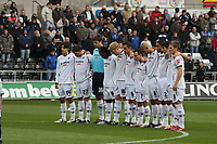 Pictured: Swansea City Players during a one minute silence <br />