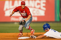 Johnson City second baseman Mike Folli (4) tries to tag Kyle Martin (21) as he slides head first into second base with a double at Burlington Athletic Park in Burlington, NC, Saturday, August 25, 2007.