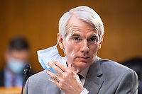 """United States Senator Rob Portman (Republican of Ohio), takes off a mask during a US Senate Finance Committee hearing on """"COVID-19/Unemployment Insurance"""" on Capitol Hill in Washington on Tuesday, June 9, 2020.<br /> Credit: Caroline Brehman / Pool via CNP/AdMedia"""