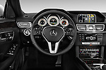 Steering wheel view of a 2014 Mercedes E350 Sedan