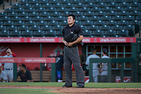 Home plate umpire Shin Koishizawa during an Arizona League game between the AZL Indians 2 and the AZL Angels at Tempe Diablo Stadium on June 30, 2018 in Tempe, Arizona. The AZL Indians 2 defeated the AZL Angels by a score of 13-8. (Zachary Lucy/Four Seam Images)