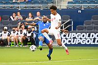 KANSASCITY, KS - JULY 11: Tajon Buchanan #12 of Canada challenged by Karl Vitulin #5 of Martinique during a game between Canada and Martinique at Children's Mercy Park on July 11, 2021 in KansasCity, Kansas.