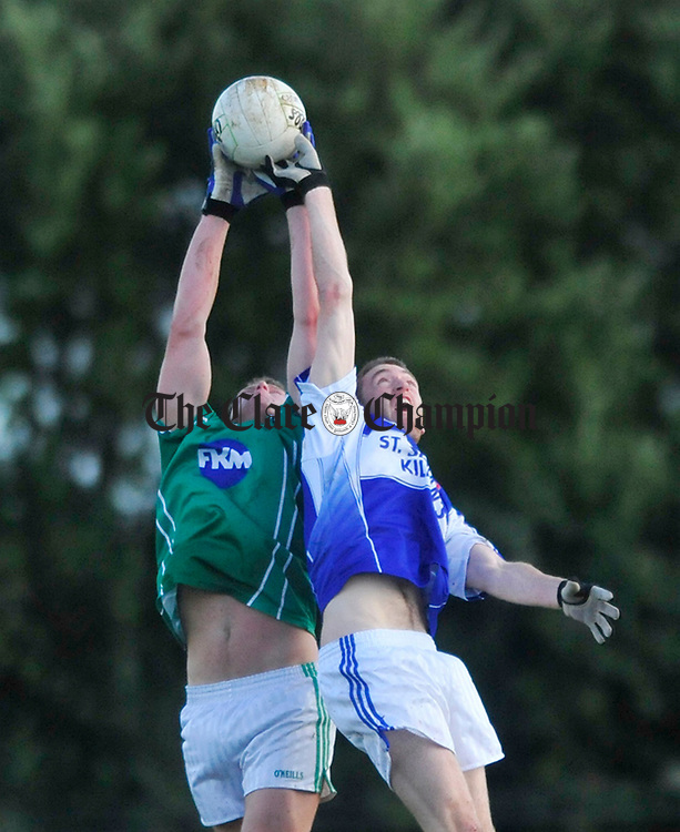 Kilrush's John Moody and Kilkee's Kevin Larkin battle for posession. Photograph by Declan Monaghan