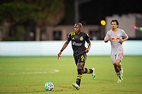LAKE BUENA VISTA, FL - JULY 16: Darlington Nagbe #6 of the Columbus Crew SC dribbles the ball during a game between New York Red Bulls and Columbus Crew at Wide World of Sports on July 16, 2020 in Lake Buena Vista, Florida.