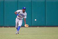 Omaha Storm Chasers center fielder Orlando Calixte (3) goes to grab a ground ball during a game against the Oklahoma City Dodgers at Chickasaw Bricktown Ballpark on June 16, 2016 in Oklahoma City, Oklahoma. Oklahoma City defeated Omaha 5-4  (William Purnell/Four Seam Images)