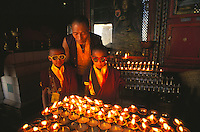 Thumpten's twin monks and grandfather with butter lamps at Swayambunath Stupa.
