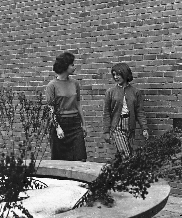 Bethel Park Senior High School:  View of students walking through building 1's courtyard to get to their next class.  Marianne Kozora is on the right. The new Bethel Senior High School was dedicated on October 23, 1960, but the campus would not grow to its current size until seven years later. Phase II of the construction was completed in 1964 with the addition of another academic building and the industrial arts building. Phase III was completed in 1967 with the construction of the fourth academic building and a 6,300 seat football stadium and track, three tennis courts, seven basketball courts, and a baseball field.