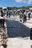 Myanmar, Burma, near Kalaw.  Burmese Road-Building Crew at Work.
