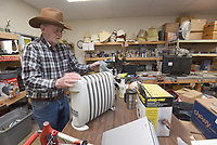 WARMTH AT A BARGAIN<br />Tom Sullivan, a volunteer at Care and Share thrift store in Gravette, cleans a donated portable heater on Tuesday Jan. 12 2021 at the store located on Arkansas 59 south of downtown Gravette. The store sells all kinds of items from hardware to clothing to electronics. It's affiliated with several churches in the Gravette area, volunteers said. Go to nwaonline.com/211013Daily/ to see more photos.<br />(NWA Democrat-Gazette/Flip Putthoff)