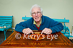James Flynn Killarney who restores furniture with the Killarney table he bought from Boston