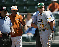Baylor Coach Steve Smith (34) meets with Texas Coach Auggie Garrido prior to the Texas Longhorns hosting the Baylor Bears on May 3rd, 2008. Photo by Andrew Woolley / Four Seam Images.