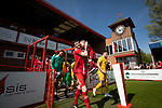 The players walking on to the pitch before Ilkeston Town (in red) host Walsall Wood in a Midland Football League premier division match at the New Manor Ground, Ilkeston. The home team were formed in 2017 taking the place of Ilkeston FC which had been wound up earlier that year. Watched by a crowd of 1587, their highest of the season, the match was top versus second, however, the visitors won 4-0 and replaced their hosts at the top of the division on goal difference with two matches to play