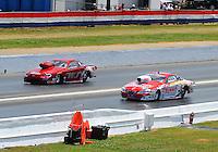 May 15, 2011; Commerce, GA, USA: NHRA pro stock driver Greg Anderson (right) along side Warren Johnson during the Southern Nationals at Atlanta Dragway. Mandatory Credit: Mark J. Rebilas-