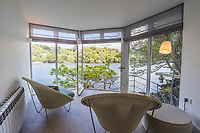 BNPS.co.uk (01202 558833)<br /> Pic: March&Petit/BNPS<br /> <br /> Pictured: A room with a view of the River Dart.<br /> <br /> The ultimate riverside lifestyle is up for grabs with this waterfront home on the market for £3m.<br /> <br /> Rosebank is in an unrivalled spot on the banks of the River Dart, close to a historic church and castle, with spectacular views over the water.<br /> <br /> The three-bedroom property in Dartmouth, Devon, has its own boathouse and direct access to the river, as well as a superb riverside terrace.<br /> <br /> The house is close to the mouth of the river, with St Petrox Church and Dartmouth Castle as its neighbours, which are just visible from the veranda.
