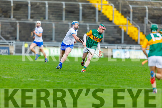 Kerry's Sean Weir uses the hand pass as Waterford's Shane Ryan attempts to hook him, as he clears another Waterford attack in the Munster Senior Hurling League in Austin Stack Park on Sunday