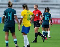 ORLANDO, FL - FEBRUARY 18: Referee Katja Koroleva talks to Marta #10 of Brazil during a game between Argentina and Brazil at Exploria Stadium on February 18, 2021 in Orlando, Florida.