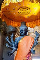 Cambodia, Angkor Wat.  Vishnu Statue inside the Entrance to the temple.