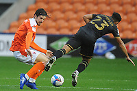 Blackpool's Jordan Williams vies for possession with Milton Keynes Dons' Louis Thompson<br /> <br /> Photographer Kevin Barnes/CameraSport<br /> <br /> The EFL Sky Bet League One - Blackpool v Milton Keynes Dons - Saturday 24 October 2020 - Bloomfield Road - Blackpool<br /> <br /> World Copyright © 2020 CameraSport. All rights reserved. 43 Linden Ave. Countesthorpe. Leicester. England. LE8 5PG - Tel: +44 (0) 116 277 4147 - admin@camerasport.com - www.camerasport.com