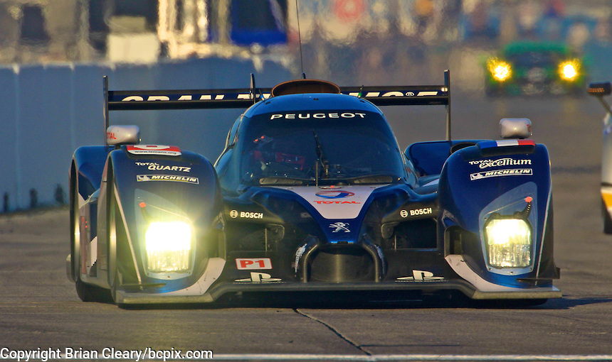 The #8 Peugeot of Stephane Sarrazin, Franck Montagny and Pedro lamy races down the frontstretch during morning warmup before the 12 Hours of Sebring, Sebring International Raceway, Sebring, FL, March 19, 2011.  (Photo by Brian Cleary/www.bcpix.com)