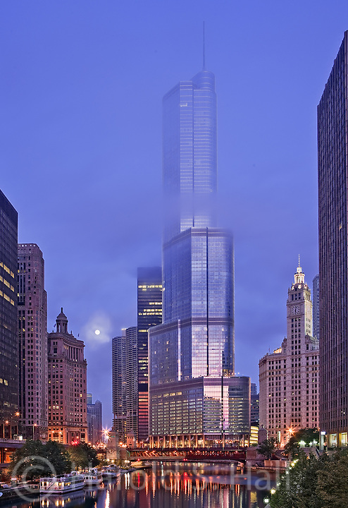 The Trump Tower is seen through a morning fog along the Chicago River.