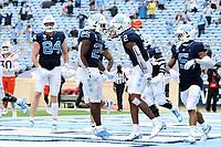 CHAPEL HILL, NC - OCTOBER 10: Dyami Brown #2 of North Carolina celebrates his 43-yard touchdown reception with teammate Javonte Williams #15 during a game between Virginia Tech and North Carolina at Kenan Memorial Stadium on October 10, 2020 in Chapel Hill, North Carolina.