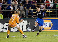 Ronnie O'Brien (7) kicks the ball against Dynamo's Wade Barrett (24) for the goal in the 50th minute.San Jose Earthquakes tied Houston Dynamo 1-1 at Buck Shaw Stadium in Santa Clara, California. September 13, 2008.