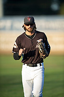 Salem-Keizer Volcanoes right fielder Nick Hill (14) jogs off the field between innings of a Northwest League game against the Eugene Emeralds at Volcanoes Stadium on August 31, 2018 in Keizer, Oregon. The Eugene Emeralds defeated the Salem-Keizer Volcanoes by a score of 7-3. (Zachary Lucy/Four Seam Images)