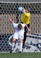 Tomas Gomez (1) of Georgetown punches the ball away from Cole Stringer (15) of Old Dominion during the second round of the NCAA tournament at Shaw Field in Washington, DC. Georgeotown defeated Old Dominion, 3-0.
