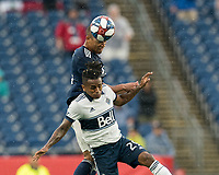 FOXBOROUGH, MA - JULY 17: Brandon Bye #15 and Yordy Reyna #29 battle for head ball during a game between Vancouver Whitecaps and New England Revolution at Gillette Stadium on July 17, 2019 in Foxborough, Massachusetts.