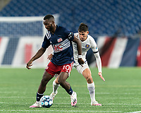 FOXBOROUGH, MA - AUGUST 7: Mayele Malango #10 of New England Revolution II controls the ball as Juan Pablo Monticelli #55 of Orlando City B defends during a game between Orlando City B and New England Revolution II at Gillette Stadium on August 7, 2020 in Foxborough, Massachusetts.