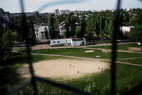 A group of boys, seen from the balcony of a residential apartment block in Tiraspol, play football. Transnistria. Also known as Trans-Dniestr or Transdniestria, Transnistria, located mostly on a strip of land between the Dniester River and the eastern Moldovan border with Ukraine, broke away from Moldova in 1990 and although a de facto independent state, governed by the Pridnestrovian Moldavian Republic (PMR), is not recognised internationally.