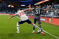 SAINT PAUL, MN - MAY 12: Jake Nerwinski #28 of Vancouver Whitecaps FC and Hassani Dotson #31 of Minnesota United FC battle for the ball during a game between Vancouver Whitecaps and Minnesota United FC at Allianz Field on May 12, 2021 in Saint Paul, Minnesota.