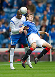Rangers v St Johnstone....28.08.10  .Michael Duberry gets the better of Nikica Jelavic.Picture by Graeme Hart..Copyright Perthshire Picture Agency.Tel: 01738 623350  Mobile: 07990 594431