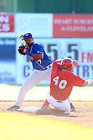 Auburn Doubledays Second Baseman Oliver Dominguez (7) turns a double play as Joseph Bergman slides in during a game vs. the Batavia Muckdogs at Dwyer Stadium in Batavia, New York July 3, 2010.   Auburn defeated Batavia 4-0.  Photo By Mike Janes/Four Seam Images