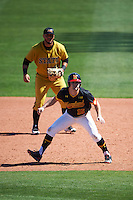 Maryland Terrapins Patrick Hisle (15) leads off first base in front of first baseman Gustavo Rios (40) during a game against the Alabama State Hornets on February 19, 2017 at Spectrum Field in Clearwater, Florida.  Maryland defeated Alabama State 9-7.  (Mike Janes/Four Seam Images)