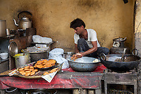 Jaipur, Rajasthan, India.  Streetside Fast-food Kitchen, Frying Balls of Wheat Flour in Oil.
